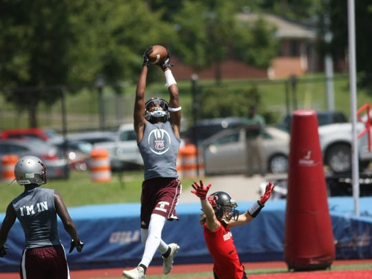 A West Creek player reaches up to snag the ball against Rossview during their 7-on-7 competition Tuesday at Austin Peay's Fortera Stadium.