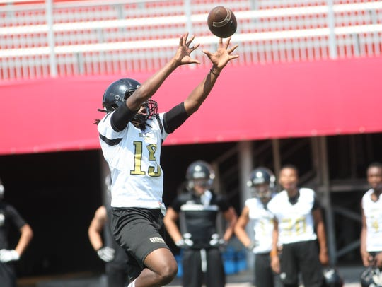 A Kenwood player leaps to make a catch during 7-on-7