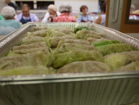 A pan of 60 halupki is prepared to enter the oven on