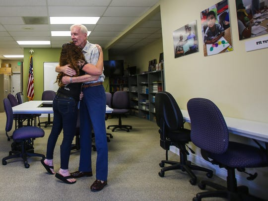 Aty Gonzalez, 38, left, hugs her citizenship class teacher Bill Nichols, 78, right, on Wednesday, July 19, 2017, at the Literacy Volunteers of Collier County offices.