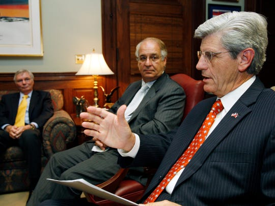In this 2011 photo, then-Lt. Gov. Phil Bryant, right,