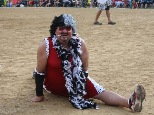 A Delhi Skirt Game participant dressed as Cruella de Vil did the splits at first base during a previous game. This year's charity softball game will be Friday, Aug. 4, at Delhi Park.