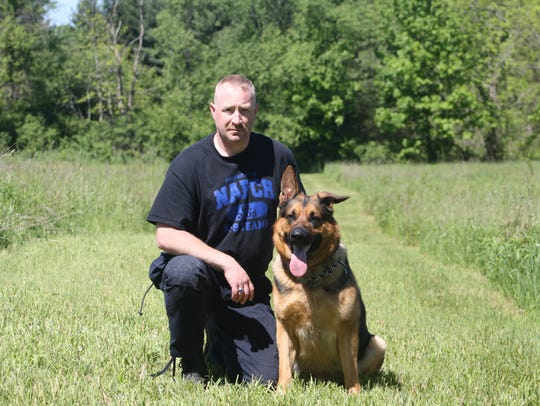 Pinckney Police K-9 Officer Steve Hart and his partner,