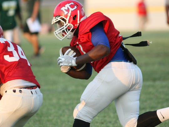 A Montgomery Central running back pounds through the