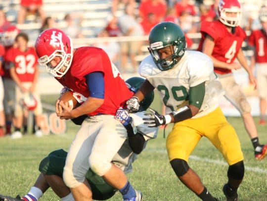 Northwest defenders pull down a Montgomery Central