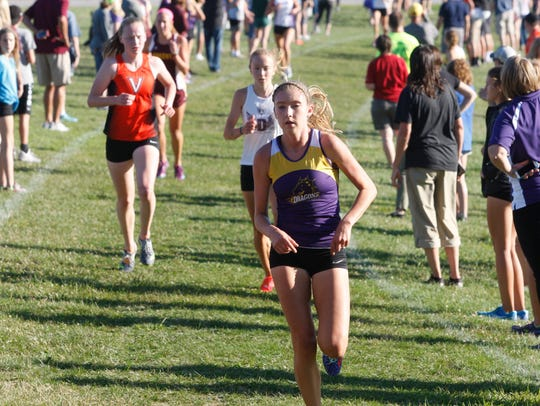 Johnston's Jessica McKee pulls away from the field
