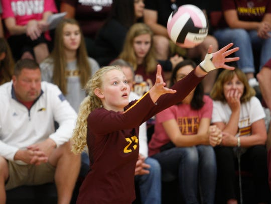 Ankeny's Phyona Schrader serves the ball during the