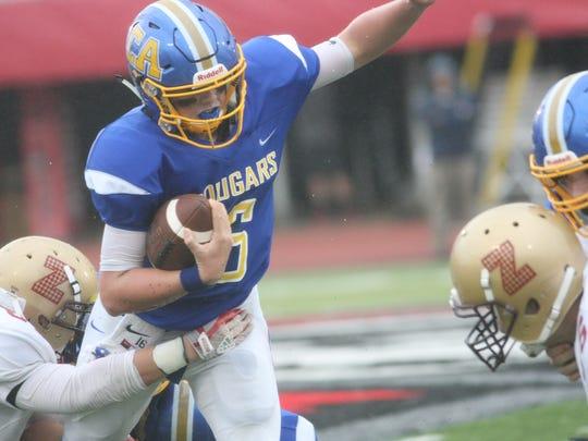 Clarksville Academy quarterback Bryce Robinson tries