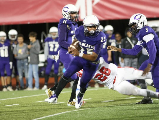 Clarksville High's Jaden Ramos (25) looks for room