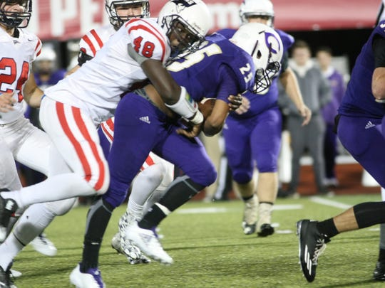 Clarksville High's Jaden Ramos fights for extra yards