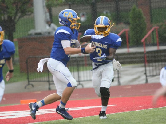 Clarksville Academy quarterback Bryce Robinson fakes