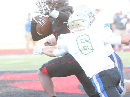 Rossview's Fred Orr tries to break the tackle of Wilson