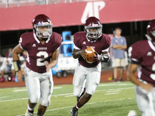 West Creek's Taieeb Dennis runs with the football with