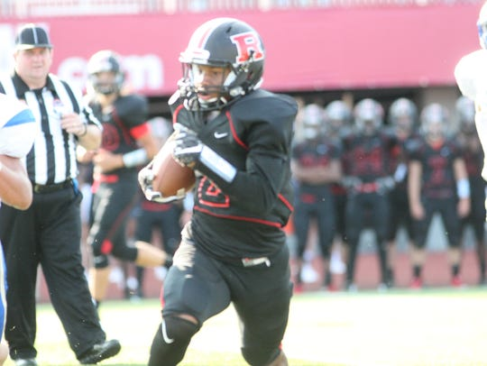 Rossview's Fred Orr runs for room against Wilson Central