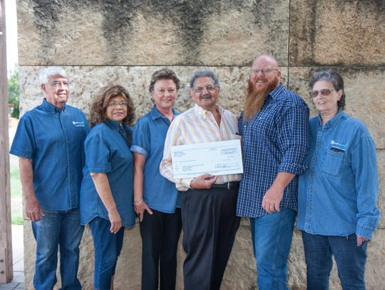 Members of the West Texas Rattlers Club present a $5,000