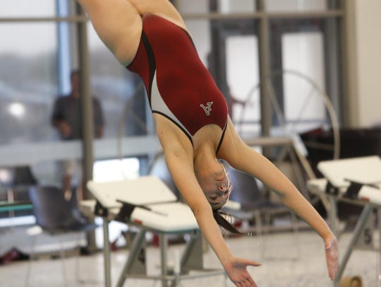 Ankeny's Sofia Wombacher dives into the pool during