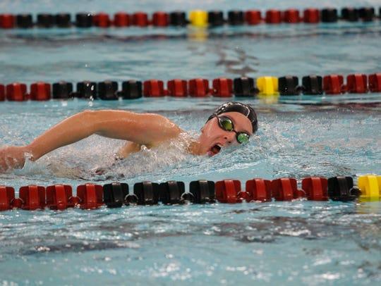 Ankeny's Erin Doruska swims to a victory in the 500
