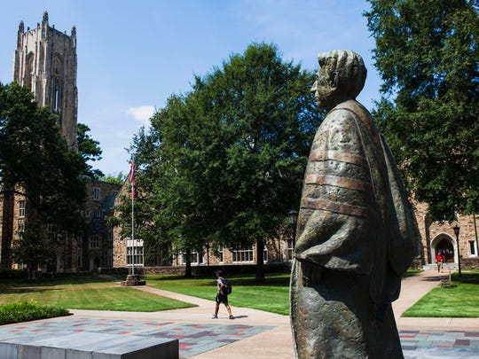 August 29, 2016 - A student passes a statue of former president Charles Edward Diehl at Rhodes College. (Yalonda M. James/The Commercial Appeal)