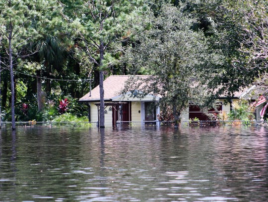 A flooded home along the Orange River in Buckingham.