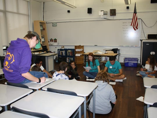 Farmington High School juniors and seniors work with