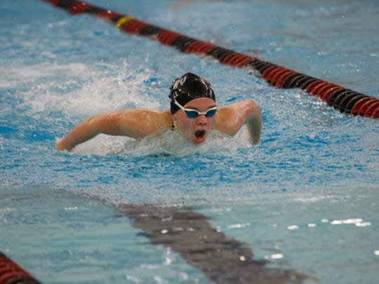 Ankeny's Scout Bergwall competes in the 100 butterfly