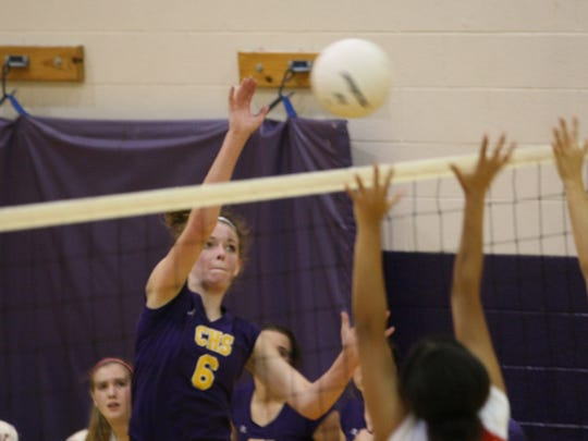 Clarksville High's Sadie Walker (6) gets the ball up and over Rossview defenders at the net during their volleyball match Thursday at CHS.