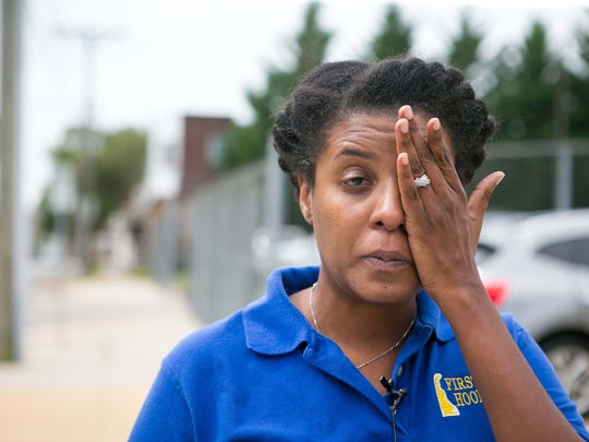 Erica Dorsett, who has children attending Thomas Edison Charter School in Wilmington, is upset at the firing of the head of the school.