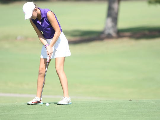 Clarksville High's McKinley Cunningham putts the ball on the 18th green during the the Region 5, Large School golf tournament Monday at Swan Lake.