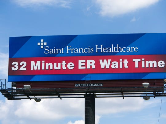 "A billboard along northbound I-95 near exit 6 in Wilmington of Saint Francis Healthcare promoting their 32-minute ER wait time. The hospital received a ""C"" grade by Leapfrog, a hospital watchdog group."