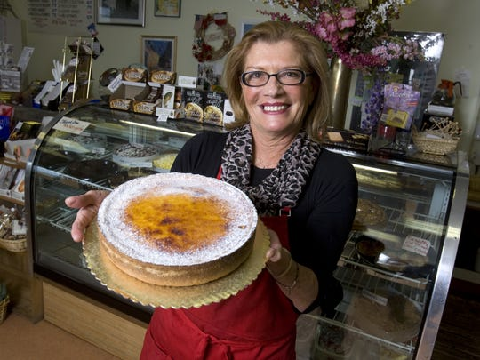 A 2010 photo of Louisette Amblard with creme brulee at her Bon Appetit cafe off Concord Pike in Brandywine Hundred