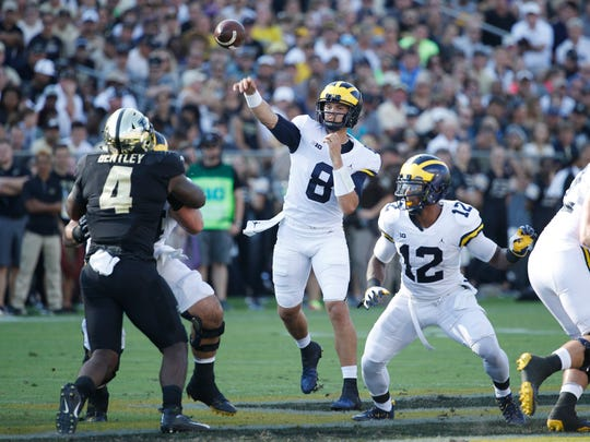 John O'Korn takes over at quarterback for Michigan,