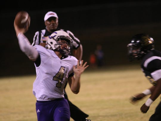 Clarksville High quarterback Ford Cooper throws the