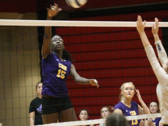Clarksville High's Deja Wall (15) looks to spike the