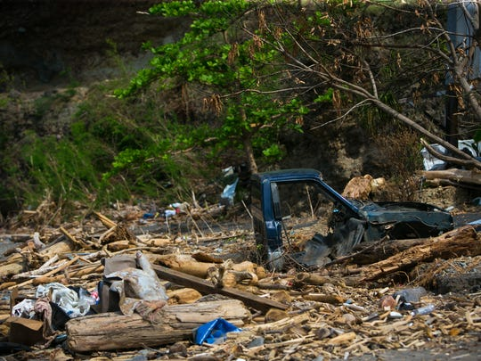 Destroyed vehicles lay in rubble in Colihaut, Dominica, where strong rushing water and debris forced their way through the village from Hurricane Maria.