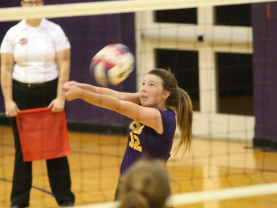 Clarksville High's Morgan Holt (12) keeps the ball