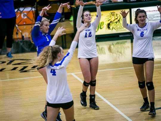 Barron Collier celebrates scoring against Naples during the Class 7A-12 championship volleyball match at Palmetto Ridge High School on Thursday, Oct. 19, 2017.