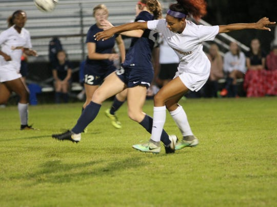 Clarksville High's Destiny Hill fights for the ball