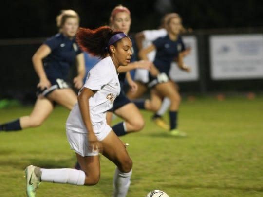 Clarksville's Destiny Hill sprints down field against