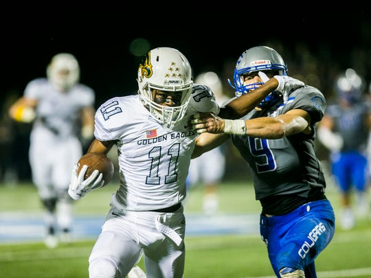 Naples senior wide receiver Taejon Wright runs the ball against Barron Collier on Friday, Oct. 27, 2017. Naples won with a final score of 16-15 at Barron Collier High School.