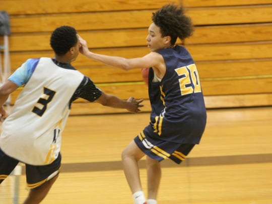 Northeast High's boys basketball team practices in