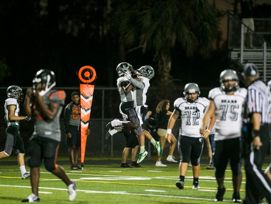 Palmetto Ridge celebrates a touchdown after scoring against Lely last year.