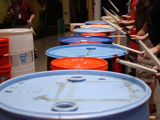 Empty plastic drums are instruments for members of