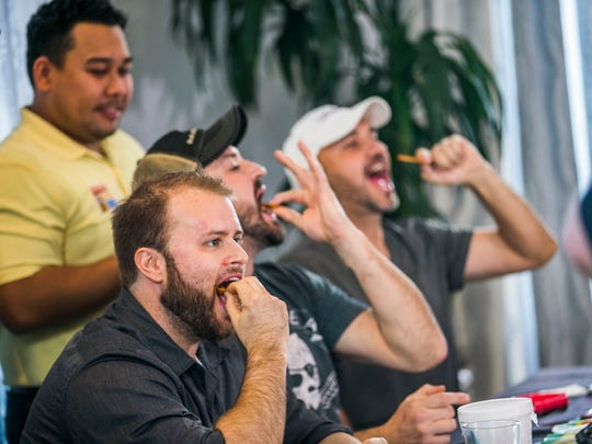 Participants compete in the Paqui Carolina Reaper Madness chip challenge on Wednesday, Nov. 9, 2017.