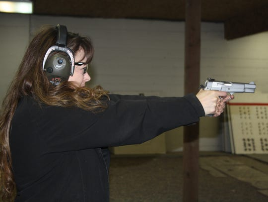 Tammy Evans practices her shooting skills with the