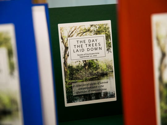 """Fifth grade students present their book """"The Day the Trees Laid Down"""" in the cafeteria at Pelican Marsh Elementary on Friday, Nov. 17, 2017. The book is a collection of stories from students about their experiences in Hurricane Irma."""