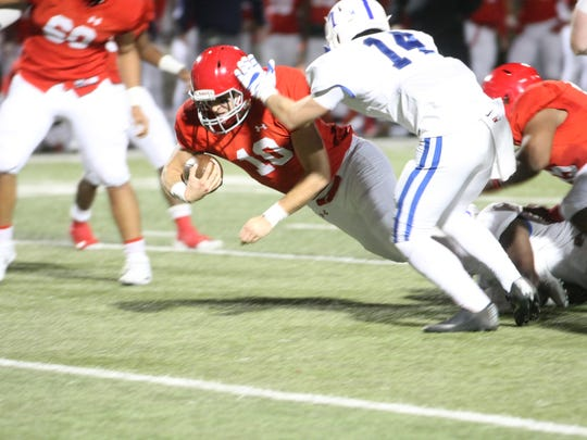 Brentwood Academy quarterback Gavin Schoenwald dives for extra yards in the first half against McCallie in the Division II, Class AAA state semifinal game Friday night.