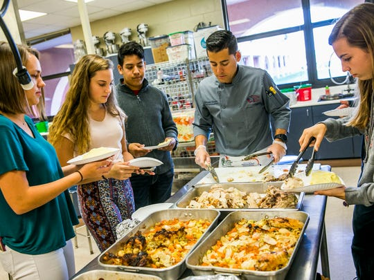 Students in a culinary class at Estero High School learn how to prepare the Thanksgiving basics from Chef Jeremy Jasper on Monday, Nov. 12, 2017.