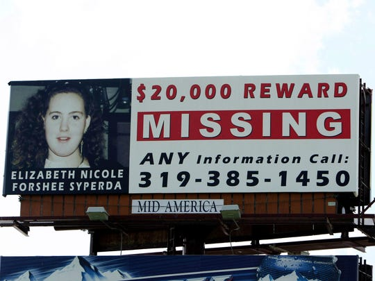 In this Wednesday, July 14, 2010 photo, a billboard offering a $20,000 reward for information about Elizabeth Nicole Forshee Syperda, is displayed off of U.S. 34 near New London. Michael Lee Syperda has been charged in the cold-case killing of his estranged wife, Elizabeth Syperda, in Iowa, where they used to live and where she was last seen 17 years ago. Syperda was taken into custody without incident Thursday, Nov. 30, 2017,  near Glenwood Springs, Colorado, which is about 130 miles west of Denver, according to the Iowa Public Safety Department.