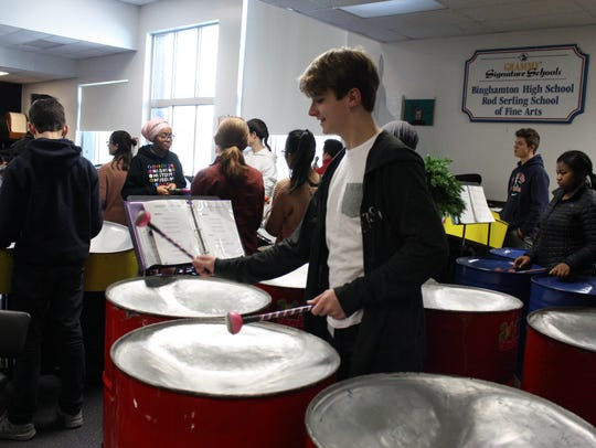 Trevor Terry plays the bass pans during a Nov. 30 rehearsal of the Binghamton High School Juice Blenders Steel Drum Band.