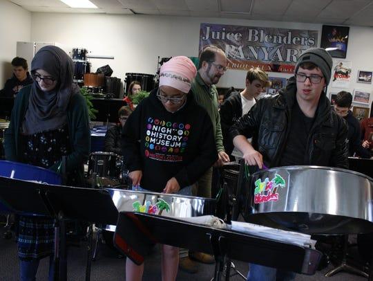 Sienna Merrill, Baiyina Richardson and Valek Rifenbury play the lead pans at a Nov. 30 of the Binghamton High School Juice Blenders Steel Drum Band.